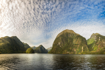 Sunglow on a Mountain Range at Doubtful Sound that looks like a fantasy land. Numerous locations in Fiordland National Park were used for the 'Middle Earth' in 'Lord of the rings""