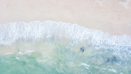 Aerial top view beautiful sea landscape, beach and wave with turquoise sea water with copy space