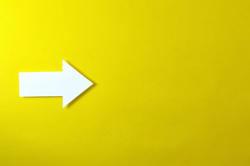 one solid arrow on yellow background