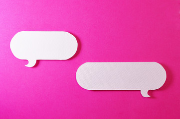 couple of rounded text bubble on pink background