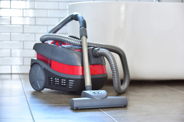 Canister vacuum cleaner for home use on the floor