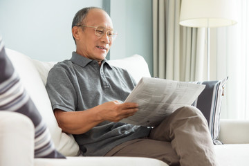 senior man reading newspaper.