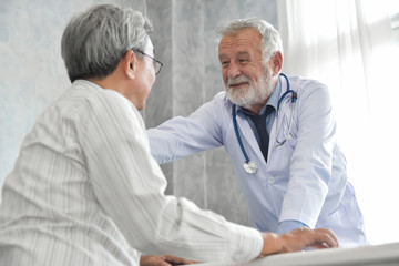 Male doctor is comforting male patient.