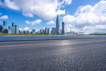 panoramic city skyline with empty asphalt road