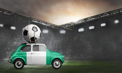 Nigeria flag on car delivering soccer or football ball at stadium