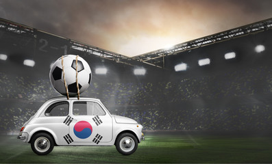 Korea flag on car delivering soccer or football ball at stadium