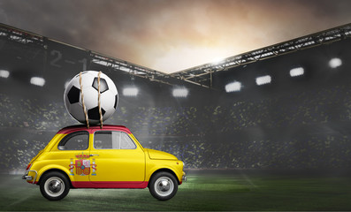 Spain flag on car delivering soccer or football ball at stadium