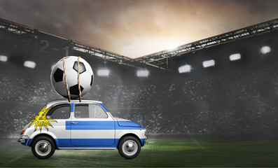 Uruguay flag on car delivering soccer or football ball at stadium
