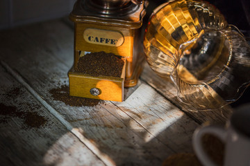 close-up of a coffee grinder with coffee in a country atmosphere