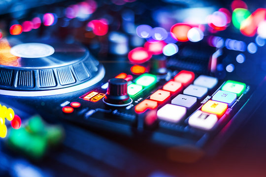 lightened Audio Control Panel with adjusted slide bar for DJ in night club. DJ professional sound mixer technology. Buttons and tabs of the audio controller for disk jockey