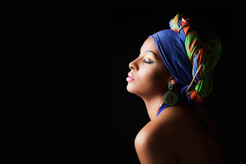 African black young woman beauty portrait with colorful turban headscarf  profile studio shot