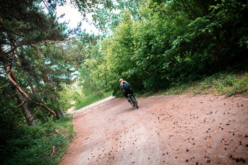 cyclist on a forest road