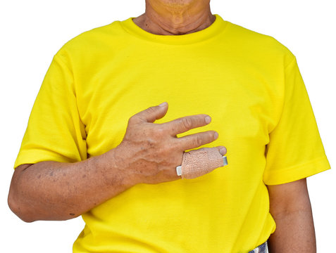 A man in yellow is showing his fingers splint because his little finger broken.