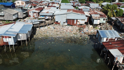 Pollution problem in poor fishing village. Plastic garbage in ocean