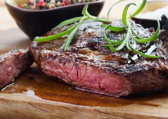 medium roast steak on wooden background