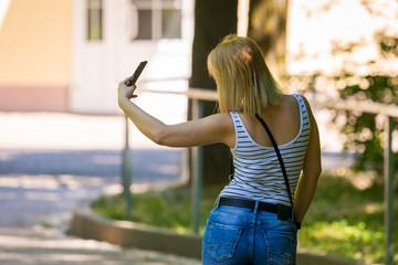 Young beauty woman make selfie for self smartphone outdoor