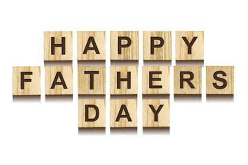 Happy Father's Day inscription on wooden cubes on white background, isolated. Happy Father's Day Concept. Greetings and gifts.