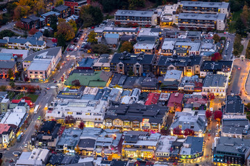Long exposure photography, close-up, the traffic in Queenstown city during sunset time.
