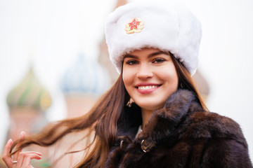 Portrait of a young beautiful girl in a white hat