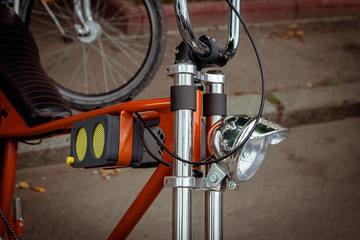 headlight and music concept with small loudspeaker on on the frame of the bike.