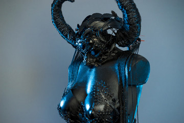 Mystery Witch. Black dress with helmet of big dark horns. pieces of metal and corset of rhinestones and lace