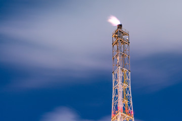 Oil refinery at night-Flaring of dangerous gases in oilfield