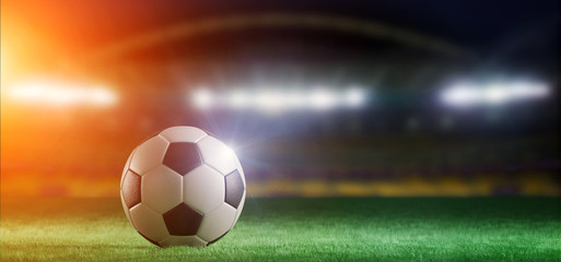Football ball on the field of a world cup stadium - 3d rendering