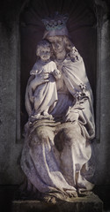 Ancient statue of the Virgin Mary with baby Jesus Christ (religion, faith, Christianity concept)