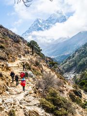 Pheriche, Nepal 04/16/2018 : Trekker with the beautiful mountains background
