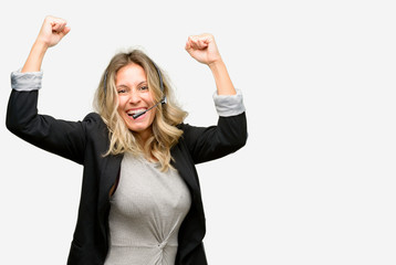 Young woman operator from call center happy and excited celebrating victory expressing big success, power, energy and positive emotions. Celebrates new job joyful