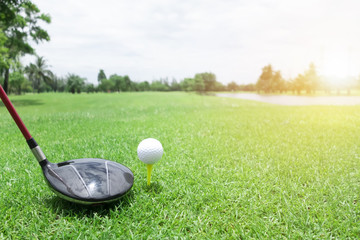 Golf ball and club on green grass .Sport Healthy concept.