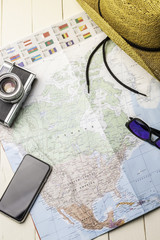 Background accessories for traveling with america map, photo camera etc.
