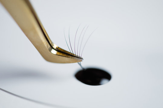 Eyelash extensions in the beauty salon. The concept of body care and beauty.