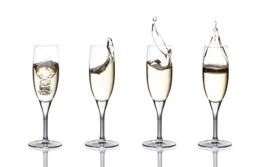 a splash of champagne in glasses on a white background