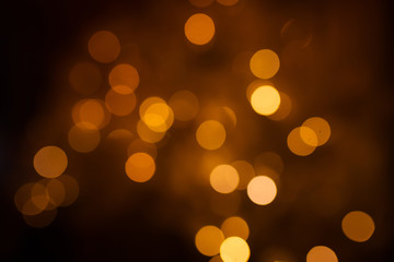 Beautiful holiday lights, blurred Bokeh. Gold and warm shades.