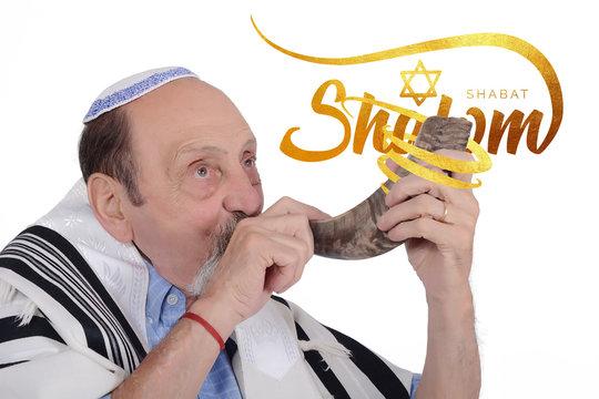 Eldery jewish man blowing the Shofar horn for Rosh Hashanah