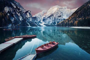 In de dag Blauwe jeans Wooden boat at the alpine mountain lake
