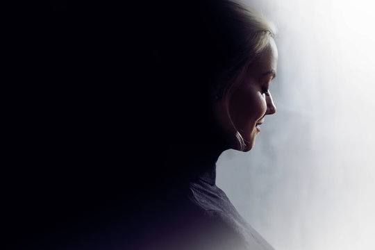 Portrait of a young calm woman in profile. Concept of the inner world and psychology, the dark and light side of personality.
