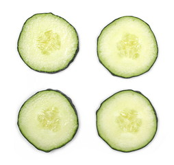 Cucumber slices isolated on white background, top view
