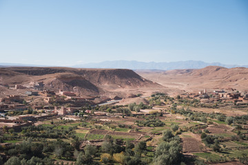 Morocco, Imlil: photo of old town in sandy mountains in hot summer with blue sky