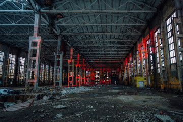 Large industrial hall illuminated by red lights. Abandoned Voronezh excavator plant Wall mural