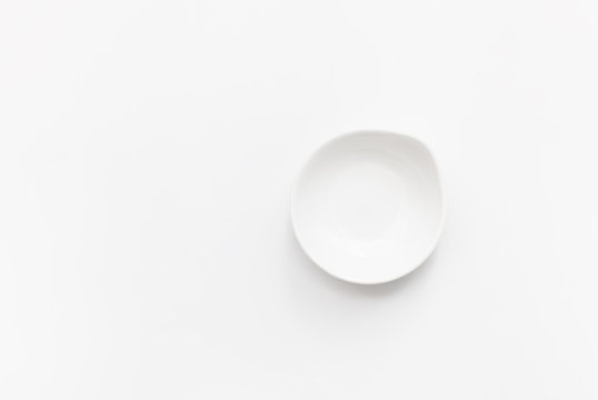 White gravy boat on white background.  Copy space text