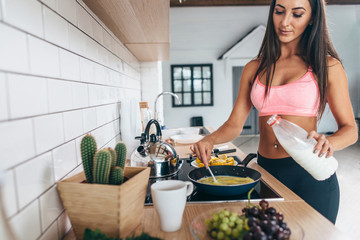 Fitness woman prepare breakfast. Sport nutrition diet before workout. Healthy lifestyle