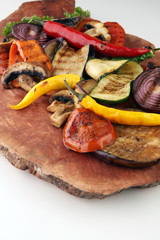 Grilled vegetables. Tomatoes, zucchini, bell pepper and fresh herbs.