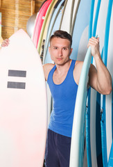 Nice man looking for surfboard in surf club