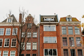 Dutch Houses Facade In Downtown Amsterdam City
