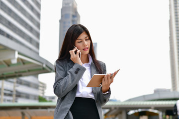 Business Communication Concepts. Young businesswoman happy to play mobile. Young businessmen communicate using mobile phones.