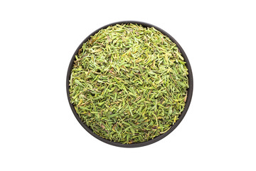 dried thyme in clay bowl isolated on white background. Seasoning or spice top view