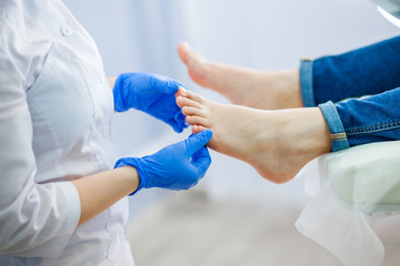 Podiatry doctor examines the foot