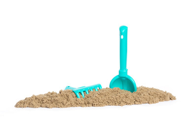 The blade and rake lie in kinetic sand. Game for children
